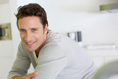 Happy man standing at home Royalty Free Stock Images