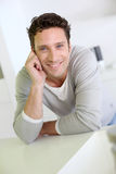 Happy man standing at home Royalty Free Stock Image