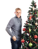 A happy man standing near the Christmas tree Stock Photos