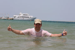 Happy man standing in the Red sea Stock Photo