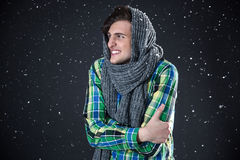 Happy man standing with snow Stock Photo