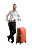 Happy man standing with suitcase royalty free stock images