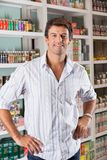 Happy Man Standing In Supermarket Royalty Free Stock Photography