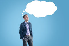 Happy man standing thinking dreaming under thought Stock Images