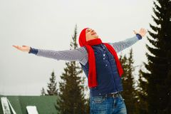 Young happy man standing on the top of mountain in snowy winter Royalty Free Stock Image