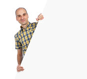 Happy man standing by white blank card Stock Photo