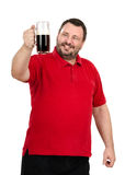Happy man staring at a dark beer mug Royalty Free Stock Images