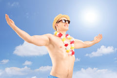 Happy man stretching arms on a holiday Royalty Free Stock Photo
