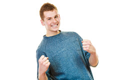 Happy man successful with arms up clenching fist Stock Image