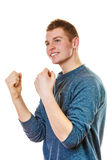 Happy man successful with arms up clenching fist. Success positive emotions. Happy young man successful lad with arms up clenching fist isolated on white Stock Image