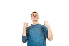 Happy man successful with arms up clenching fist. Success positive emotions. Happy young man successful lad with arms up looking upwards clenching fist isolated Royalty Free Stock Photos