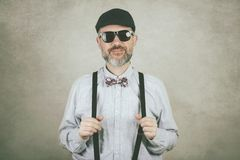 Happy man with sunglasses and bow tie stock images