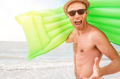 Happy man with swimming mattress Royalty Free Stock Photography