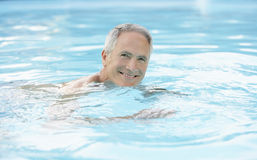 Happy Man Swimming In Pool Royalty Free Stock Image