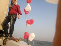 Happy man by sailing in boat Stock Image