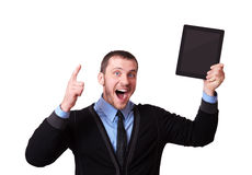 Happy man with a tablet in his hand and raised finger up, isolated on white Stock Image