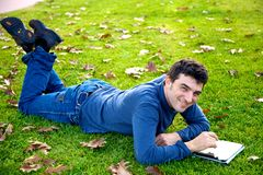 Happy man with tablet in park Royalty Free Stock Photos