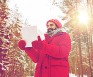 Happy man with tablet pc in winter forest stock photos