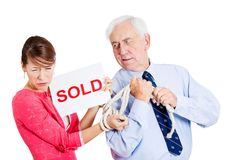 Happy man taking away sad woman Royalty Free Stock Photography
