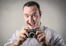 Happy man taking a picture Royalty Free Stock Image