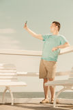 Happy man taking self picture with smartphone Royalty Free Stock Photography