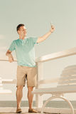Happy man taking self picture with smartphone Stock Photos