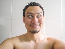 Happy man taking selfie in bathroom. stock photos