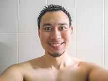 Happy man taking selfie in bathroom. Royalty Free Stock Images