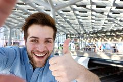 Happy man taking selfie with thumbs up Royalty Free Stock Photo