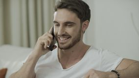 Happy man talking mobile phone. Portrait of smiling man call cell phone at home