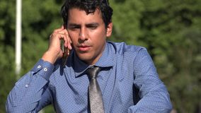 Happy Man Talking On Phone. A handsome adult hispanic man stock video