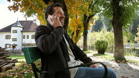 Happy man talking on the phone outdoors stock video footage