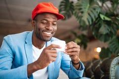 Happy man tasting mug of beverage Royalty Free Stock Photo