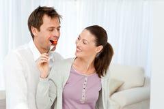 Happy man tasting a tomato Royalty Free Stock Photography