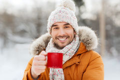 Happy man with tea cup outdoors in winter Royalty Free Stock Photos