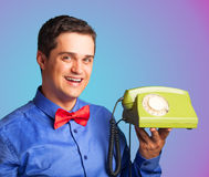 Happy man with telephone Stock Images