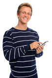 Happy man texting on cell phone. Young blonde guy holding his mobile phone isolated on white Royalty Free Stock Photos
