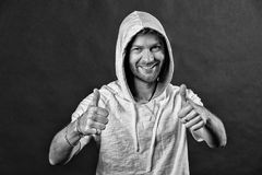Happy man with thumbs up. Bearded man smile with beard in hood. Fashion model wear hoodie tshirt. Active lifestyle and Stock Image