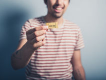 Happy man with ticket Royalty Free Stock Images