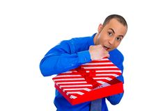 Happy man about to open unwrap red gift box Royalty Free Stock Photos