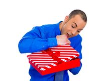 Happy man about to open unwrap red gift box Stock Images