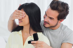 Happy man about to propose hiding eyes of his girlfriend Stock Photography