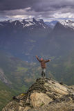 Happy man on the top of a  mountain Stock Images