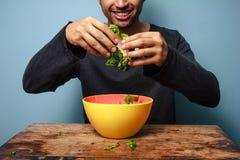 Happy man tossing salad Royalty Free Stock Photos