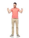Happy man touching something imaginary Stock Photo