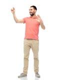 Happy man touching something imaginary Stock Image