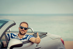 Happy man travel by car Royalty Free Stock Photos