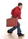 Happy man with travel suitcase . Stock Photo