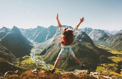 Happy Man traveler jumping with backpack. Travel Lifestyle adventure concept active summer vacations outdoor in Norway mountains success and fun euphoria royalty free stock photo