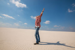 Happy man, traveler with open arms enjoying amazing world in des Royalty Free Stock Photo